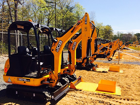 A line of JCB 8018 CTS mini-excavators awaits the kids at Diggerland USA.