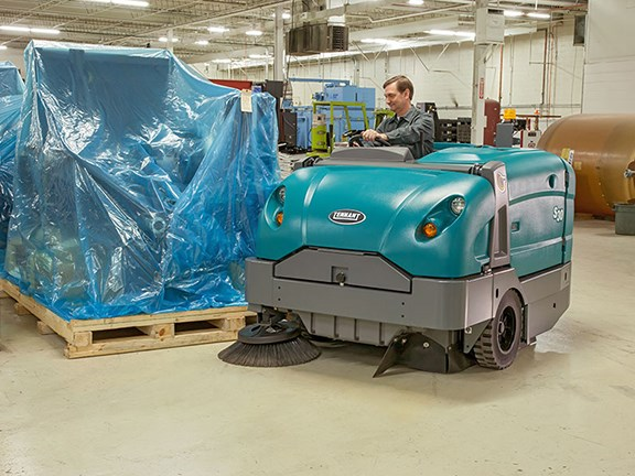 The Tennant S30 Mid-Size Rider Sweeper in use inside.