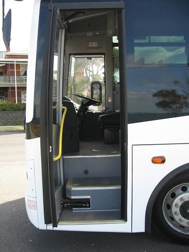 wide entry door followed by three steps on the BCI Classmaster 43
