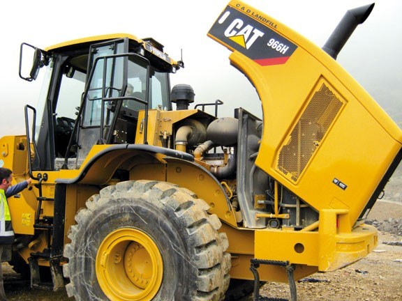 Caterpillar 966H rear hood lifts with.jpg