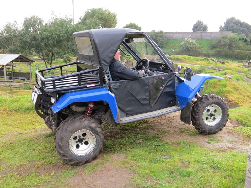 Tomcar ultility vehicle side