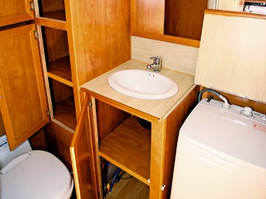 bathroom sink and washing machine in Retreat Caravans Hayman