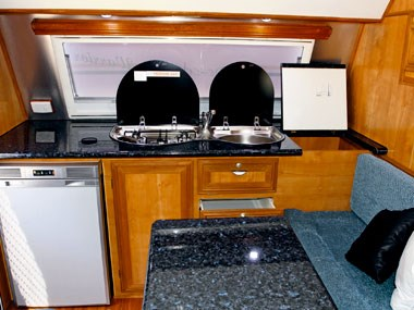 dinette and stoves inside the Desert Sky Warrior caravan