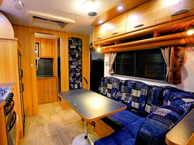 Coromal Caravans Princeton P635XC interior dinette and blue seating