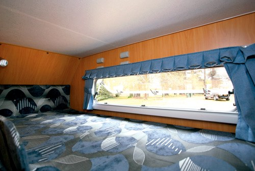 A'van Jenna HT 624 caravan top bunk and view outside