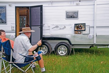 relaxing outside the 5 Star Caravans Premier MKII
