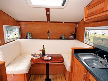 Outback RVs Overlander caravan interior lounge and dining area next to kitchen