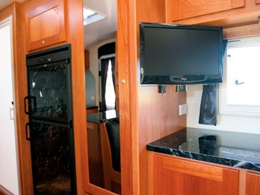 Sunland Caravans Blue Heeler TV and kitchen