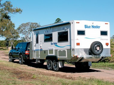 Teh Sunland Caravans Blue Heeler exterior beign towed and ready for adventure