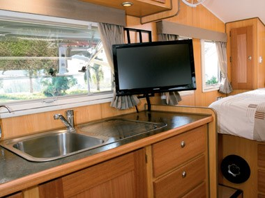 Bushtracker custom offroad caravan interior kitchen sink and tv