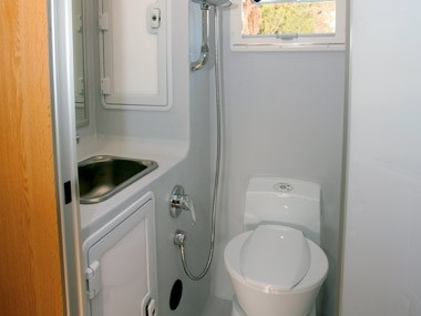 Bushtracker custom offroad caravan interior toilet and sink