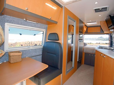 Horizon Acacia 4X4 motorhome interior view of seating and table