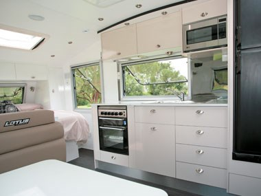 Lotus Caravans Vogue interior showing plenty of storage