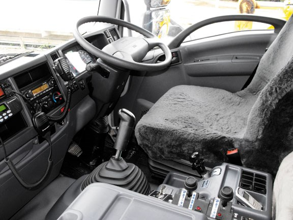 driver's seat and steering wheel in the Isuzu FXZ330 tipper truck