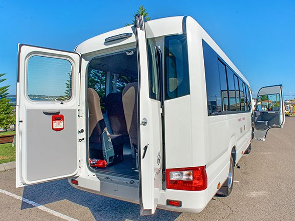 The 2017 Toyota Coaster allows for easy access and loading  from the rear