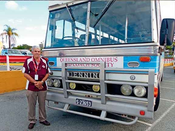 Graham Bristow in front of QOCS' Denflex bus