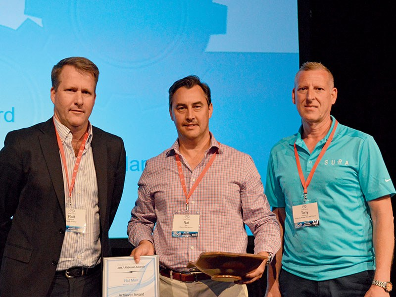 2017 BIC National Achiever Award winner Nat Muir (centre)