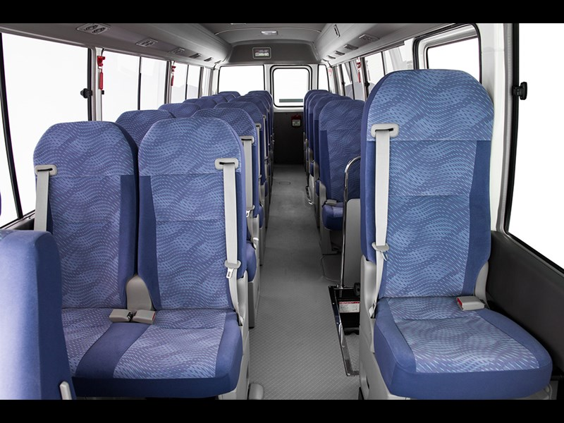 Down the aisle: looks can be deceptive because there's plenty of headroom. The seats are comfortable and now safer with three-point belts