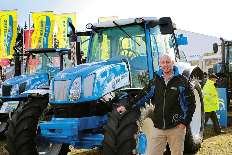 Josh Vroombout with the classic looking New Holland T6070 PLus