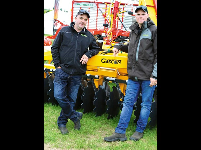 Farm Trader s Brent Lilley and Jaiden Drought checking out new gear at Southern Field Days