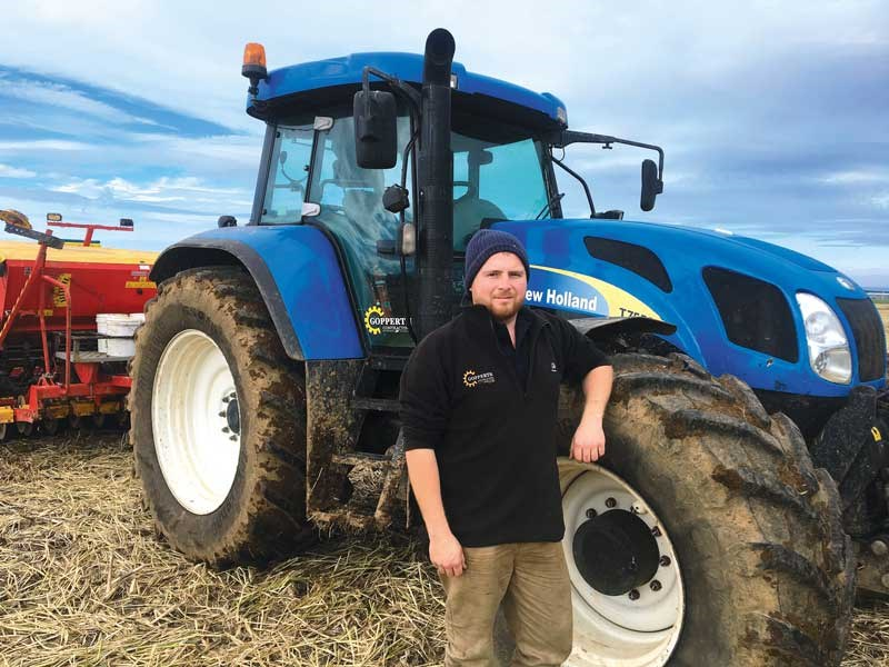 Young Farmer Phillip Hopkins uses contracting to see the world