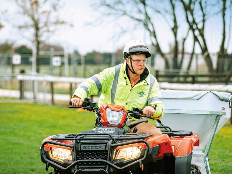 Alex Field uses a Honda quad bike to tow a spreader