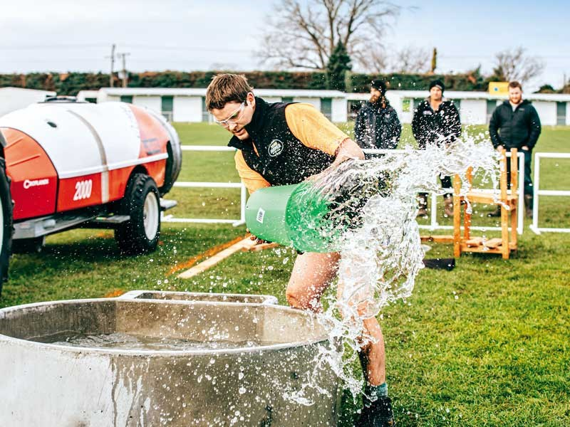 Joseph Watts empties a water trough during the agri sports challenge