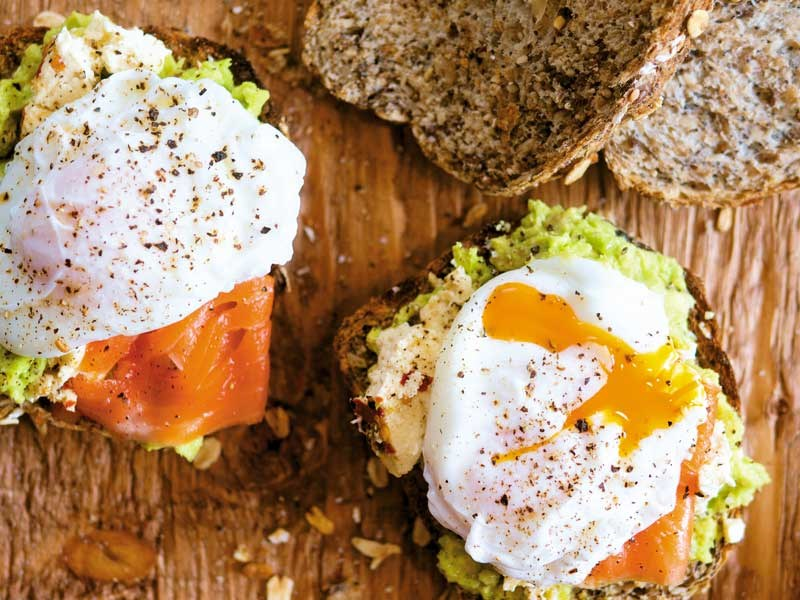 Smashed avocado, chilli feta, salmon and poached egg