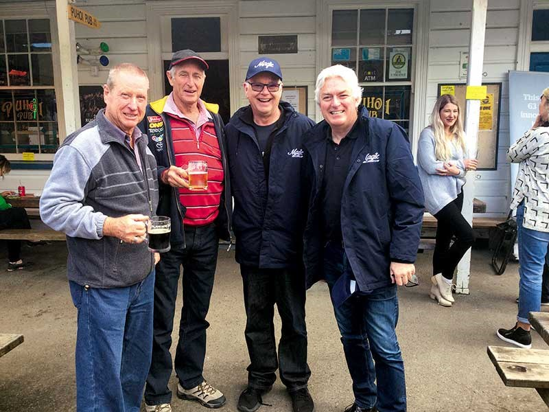 Mark Leishman and Murray Lindsay with a couple of avid Magic listeners outside the Puhoi Pub