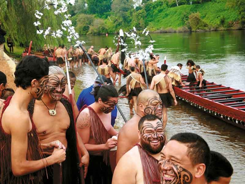 The waka are  manned and launched onto the river