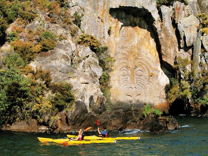 taupo mine bay carvings with kayakers