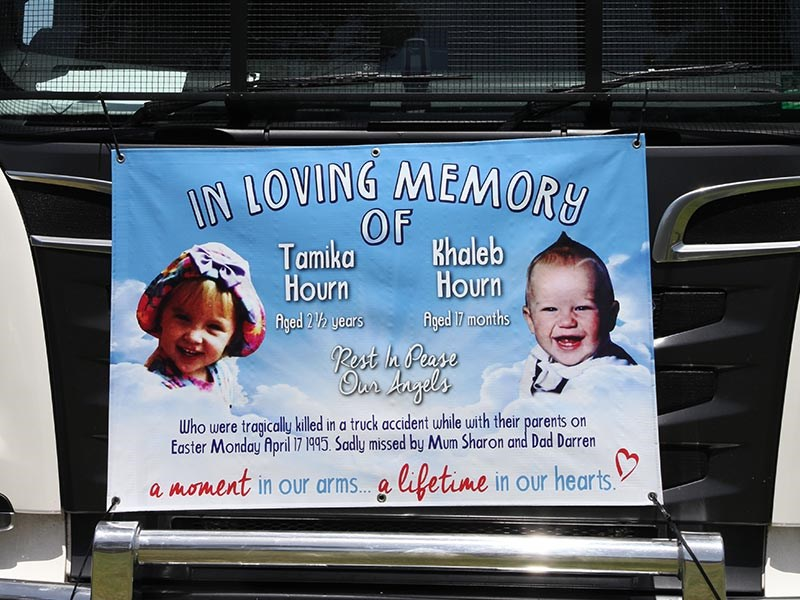 Banner on the front of a Qube Scania in memory of Tamika and Khaleb Hourn, whose names adorn the Memorial Wall.