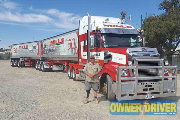 Bart Barford is eager to get back into the 2015 Freightliner Coronado 114 with a 58-inch XT sleeper cab, pictured here with Mills Freightlines' 50-year anniversary trailers.
