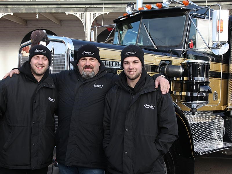 David Larsen (centre) and his sons Bradley (left) and Jake up front of the W model Kenworth at Alexandra.