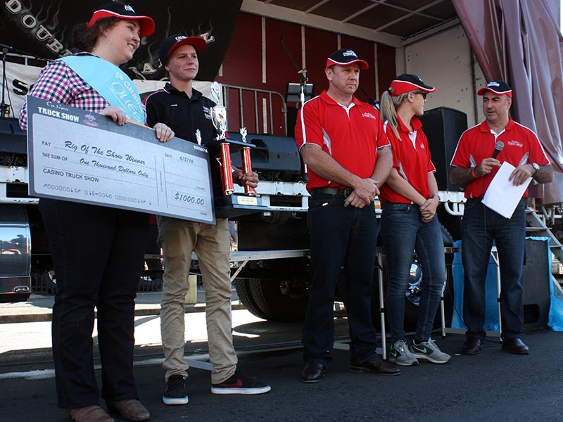 The $1000 cheque about to be presented to Rig Of The Show winner Causley Transport.