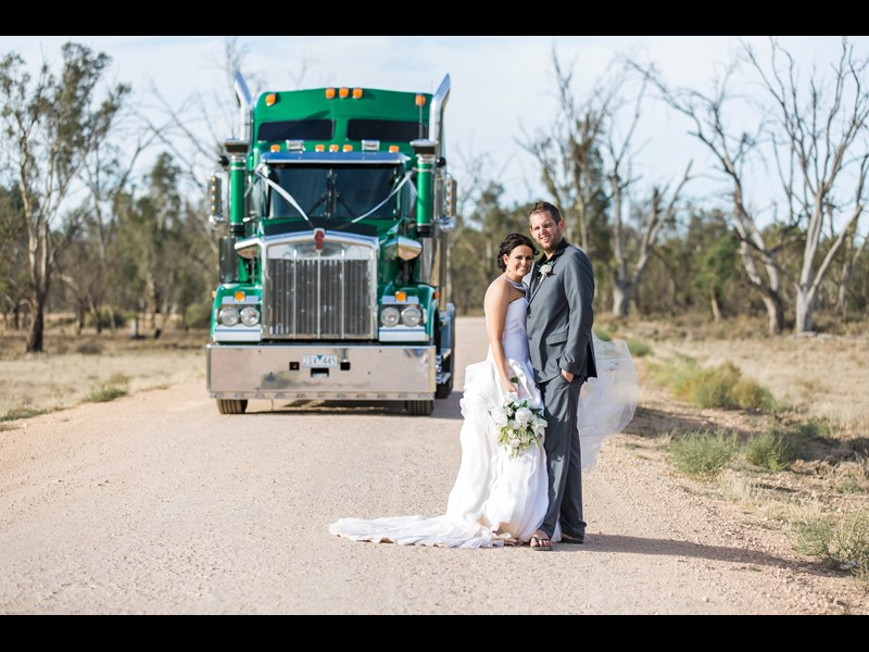The Kenworth T408 SAR makes an impressive backdrop for newlyweds Madelon and Kye