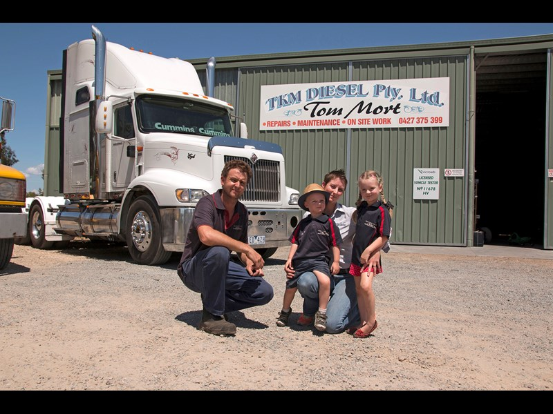 Tom and Kylie Mort with their children Mackenzie and Darcy at their Benalla workshop.