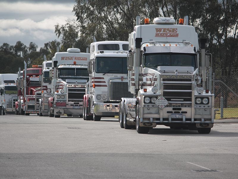 The crew from Wise Haulage rumble through the gates in the morning sun.