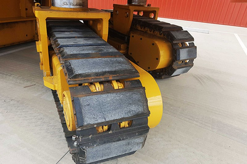 Close up of Cat PM620 crawler tracks