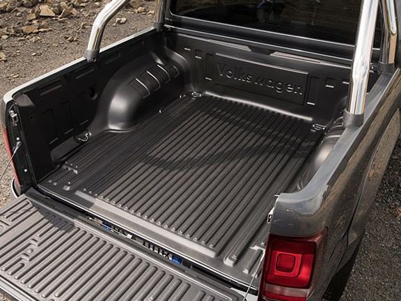 The Volkswagen Amarok Ultimate TDV6 ute can fit an Aussie-sized pallet between the wheel arches