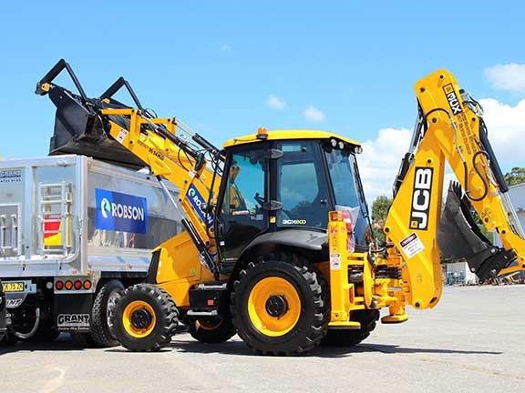 JCB 3CX backhoe loader loading truck