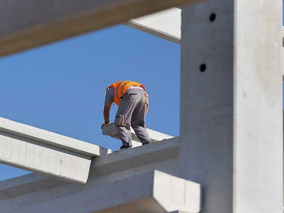 Construction worker up high without harness