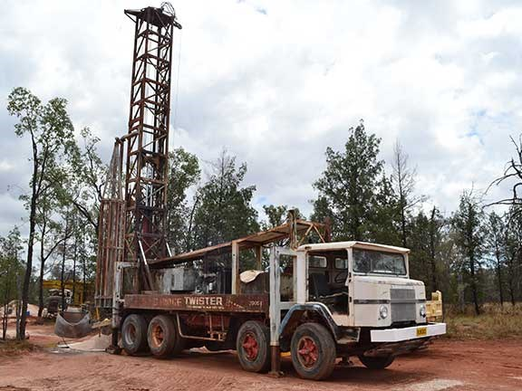 Mining drill rig on truck bed