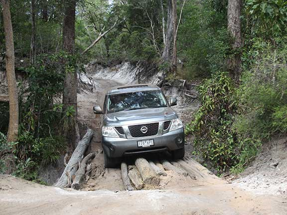 Nissan patrol 4x4 crossing log bridge