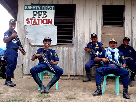 A few of the Filipino guards with shotguns in hand