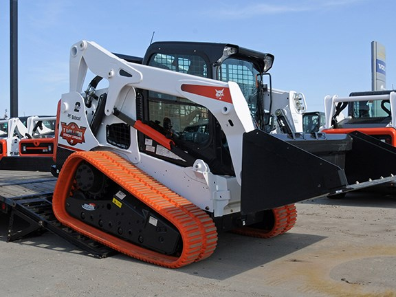 Ramps of sufficient strength are needed to support a compact loader when loading.