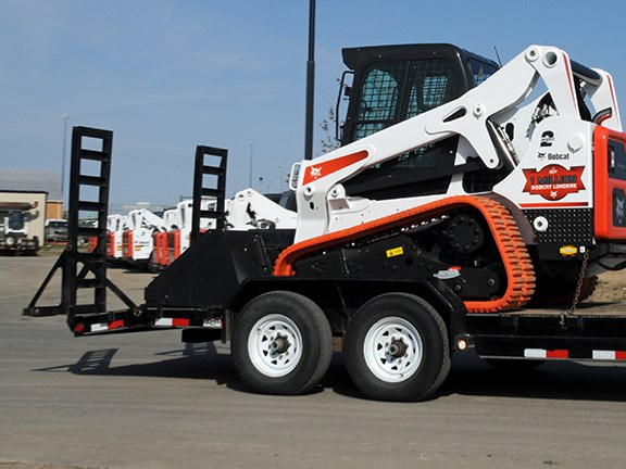 Once on the trailer, compact loader operators should lower the attachment to the floor of the trailer, stop the engine and engage the parking brake.
