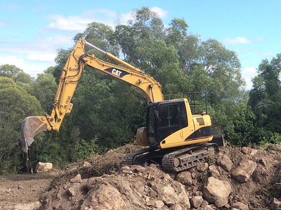 The Cat 311cu has spent a lot of time on rock work.