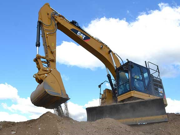The 'L' and 'CR' in the Cat 335F L CR excavator's model designation refer to long undercarriage and compact radius.