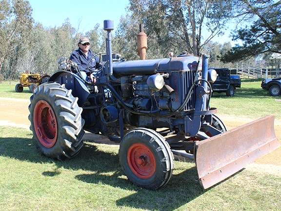 A classic Fordson tractor fitted with a dozer blade.